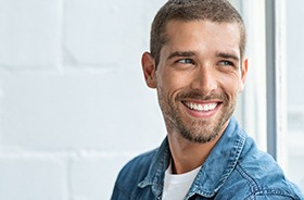 Smiling, handsome man enjoying benefits of dental bridges