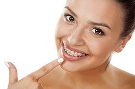Woman pointing to clear braces