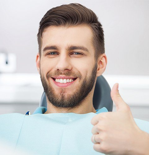 Smiling man in dental exam room