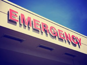 red emergency room sign against blue sky background