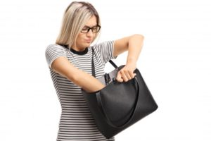 Searching purse, looking for aligner for Invisalign in Hamden
